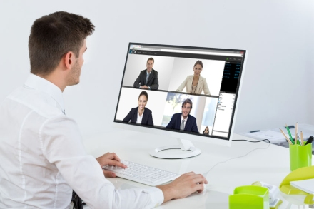 46637138 - young businessman videoconferencing with colleagues on computer